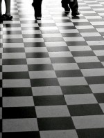 walking-on-black-and-white-floor-tiles