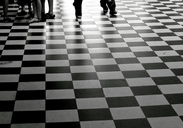 And The Rena Lopez Story Walking On Black And White Floor Tiles
