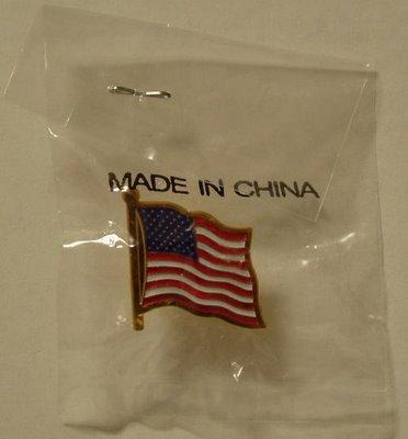 http://promokitchen.com/wp-content/uploads/2012/04/USAPinMadeInChina.jpg